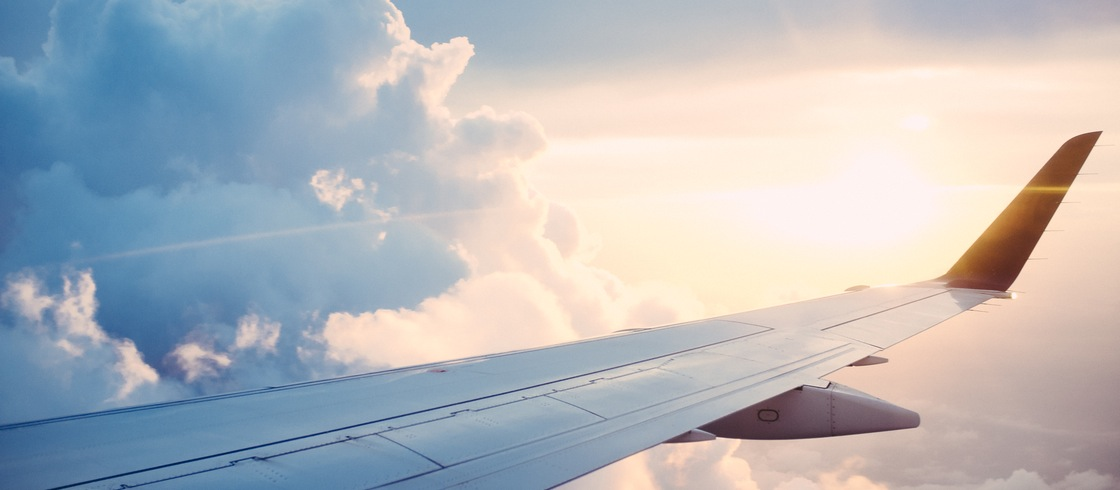Offsetting the Climate Impacts from Air Travel